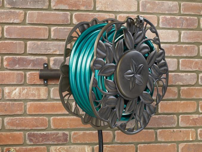 NeverLeak Decorative wall mount hose reel with swivel feature | Ames